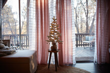 Decorated Christmas Tree In Living Room, Verandah In Background