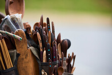Tool Belt Filled With Wooden Spoons And Knives