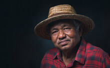 Portrait Elderly Asian Man Wearing A Hat Smile And Looking At Camera On Black Background In The Studio.