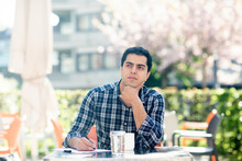 Young Man In Deep Thought At Cafe