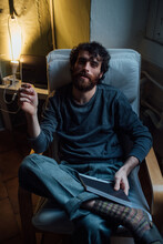 Bearded Young Man Smoking At Home