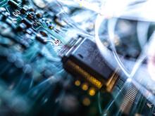 Fibre Optics Carrying Data Passing Through Electronic Circuit Boards, Close Up