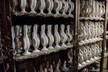 Plain Clay Jars Ready For The Kiln On Shelves At A Pottery Shop.
