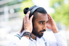 Man With Headphones Outdoors