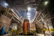 200 Ton Red Hot Steel Ingot Being Lifted From Mould In Steelworks