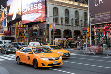 Yellow Cabs And Shop Fronts, Times Square, New York City, USA