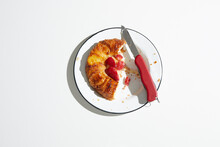 Strawberry Danish Pastry On Plate With Swiss Army Knife, Overhead View