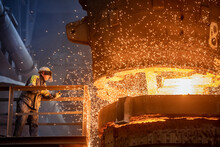 Steelworker Starting Molten Steel Pour In Steelworks