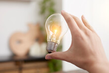 Lit Up Electric Bulb In Hand