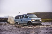 Off Road Vehicle Driving Through Water, Landmannalaugar, Iceland