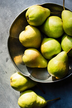 Still Life Of Pears In Metal Bowl In Sunlight