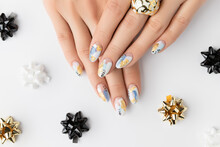 Young Adult Woman's Hands With Fashionable Nails On White Background. Spring Summer Nail Design.