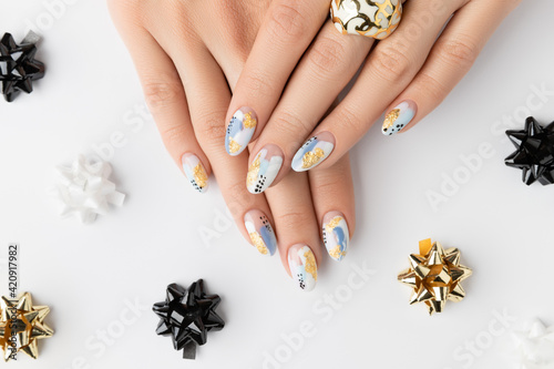 Fotografie, Tablou Young adult woman's hands with fashionable nails on white background