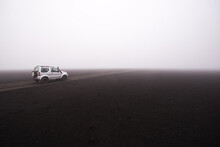 Off Road Vehicle On Dirt Track In Foggy Conditions, Landmannalaugar, Iceland