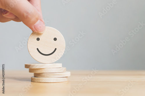 Canvastavla Hand choose wooden coins with icon face, The best excellent business services ra