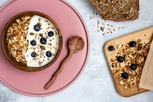 Bowl Of Muesli And Blueberries On Yogurt, Multi-seed Bread