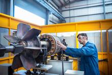 Electrical Engineer Balancing Generator Part In Electrical Engineering Factory