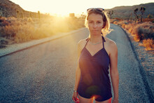 Woman On Country Road At Sunset, Joshua Tree, California, USA