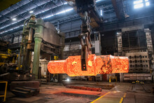 Red Hot Steel Ingot Being Craned To Forge In Steelworks