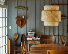 Peaceful Scene Of Dining Room In A Lakeside Cabin.