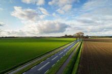 Country Road Running Through Agricultural Fields In Autumn, Lewedorp, Zeeland, Netherlands