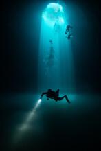 Divers Exploring Cenote Maravilla, Mexico