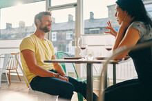 Couple Talking At Mealtime In Restaurant