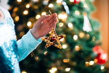 Person Holding Christmas Ornament, Star Made Out Of Popsicle Sticks
