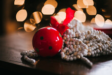 Christmas Ornaments, Red Bell And String Of Beads