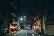Night Scene Of An Empty Street, And Old Retail And Apartment Block Buildings, Osaka, Japan