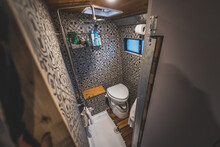 Shower Wet Room In The Campervan With Tiled Walls, Shower And Toilet.