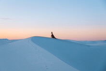 Woman On White Sand Dunes, White Sands National Monument, New Mexico, US