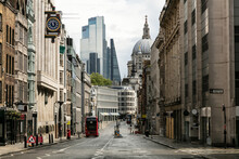 View Along Empty Fleet Street With Office Buildings And St Paul's Cathedral Among Modern High Rise Buildings In London During The Corona Virus Crisis.