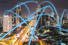 5G Connectivity, Blue Connections Crisscrossing The, Skyline Of Bangkok, Thailand At Night.