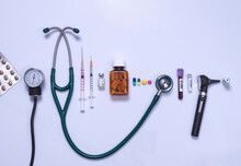 Healthcare, A Variety Of Medical Equipment Used For Diagnosis And Treatment Of A Medical Condition, Stethoscope, Medications, Otoscope And Range Of Syringes And Medicines.