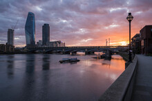 View From Blackfriars Bridge At Sunset, River Thames And Modern Buildings, And The Setting Sun.