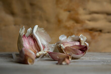 Close Up Of Garlic Cloves In Their Papery Skins.