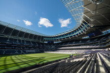 Tottenham Hotspur Football Stadium, Empty Stands And Sunshine On The Pitch.