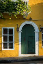 Colourful Yellow House Wall And Green Front Door In The Old City