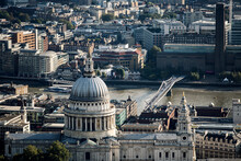 High Angle View Of The Dome Of St Pauls Cathedral Designed By Christopher Wren, And Millennium Bridge And Tate Modern Across The River Thames In London