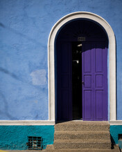 Colourful Blue Wall And Purple Painted Front Door In The Old City, Cartagena