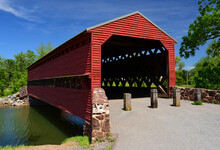 Picturesque Red Sachs  Covered  Bridge Over Marsh Creek In Springtime Near Gettysburg, Colorado