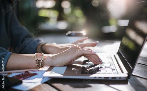 Obraz Close-up of hand asian businesswoman  using computer laptop working outdoor - fototapety do salonu