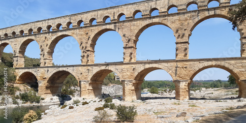 Leinwand Poster Roman aqueduct Pont du Gard a french Unesco site in Languedoc France