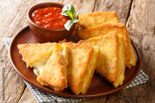 Stampa su Tela Mozzarella in Carrozza sandwich gets an extra dose of richness from a creamy egg bath and is coated in breadcrumbs for extra crunch closeup in the plate on the table