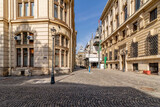 Fototapeta Uliczki - The intersection of Stavropoleos and Poștei streets in the Lipscani district in the historic center of Bucharest, Romania on a sunny day