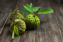 Buah Srikaya Or Sugar Apple Or Annona Squamosa, One Of Indonesian Tropical Fruits. Sweet Taste And Green Skin Fruit. Dark Wooden Background, Copy Space For Text.