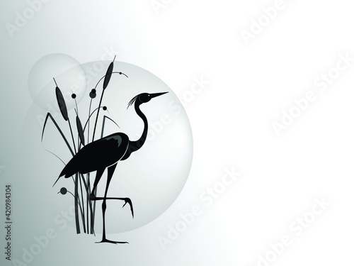 Fotografie, Obraz A silhouette of stand on one leg heron against the backdrop of a cattail bush and large sun circle