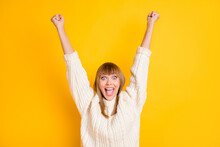 Photo Of Delighted Person Hands Fists Up Open Mouth Shout Wear Knitted Sweater Isolated On Yellow Color Background