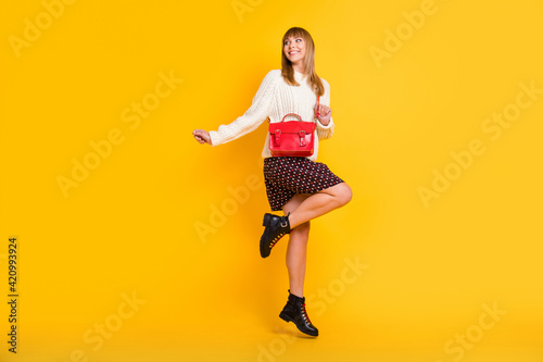 Leinwand Poster Full length profile photo of carefree charming girl look empty space jumping iso
